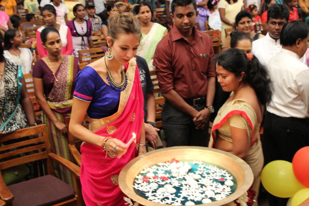 An alternative schoolies volunteer at a ceremony on her trip to Sri Lanka.